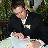 Derek Signing the Marriage Certificate